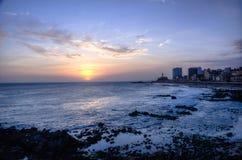 Sunset at Barra Beach with Farol da Barra Barra Lightouse on Background - Salvador, Bahia, Brazil Royalty Free Stock Photography