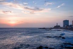 Sunset at Barra Beach with Farol da Barra Barra Lightouse on Background - Salvador, Bahia, Brazil Royalty Free Stock Images