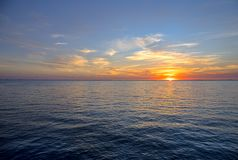 Sunset By The Barrier Island Of Egmont Key. Colorful sunset next to Egmont Key, seen in the distance. It is a barrier island in the Tampa Bay area, Florida stock photography