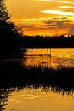 Serene Sunset On Bass Lake In Ontario`s Kawarthas. Sunset on Bass Lake in the Kawartha Lakes region of Ontario, Canada stock image