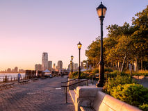 Sunset at Battery Park in New York. City Stock Images