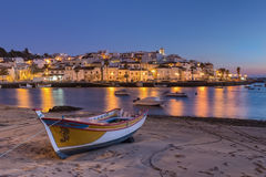 Sunset in the bay of Ferragudo, Portimao. Fishing boat. Royalty Free Stock Photos