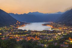 Sunset Bay of Kotor Boka Kotorska at Adriatic Sea, southwester. N Montenegro. Night airview with firework from Dinaric Alps at towns of Kotor, Risan, Tivat stock images