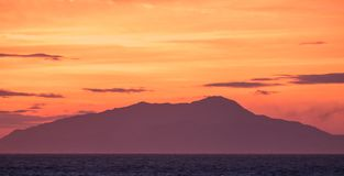 Sunset in the Bay of Naples, Italy. Mount Vesuvius can be seen on the horizon. Photographed near Sorrento . Sorrento, Italy Sunset in the Bay of Naples, Italy royalty free stock photos