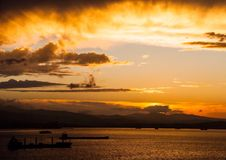 Sunset. Bay seascape clouds disk Royalty Free Stock Image