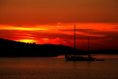 Sunset on the beach_1. Sailing-boat in sunset on a beach stock photos