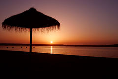 Sunset on beach. Sunshade on the beach and a beautiful Sunset at sea Stock Photography
