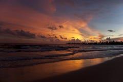 Sunset at beach. With orange sky Stock Photo
