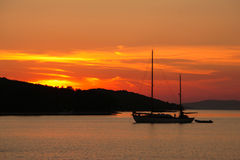Sunset on the beach_2. Sailing-boat on the beach in sunset stock photos
