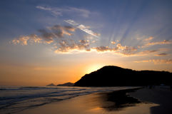 Sunset at the Beach. Sunset at the Baleia Beach in Brazil with sun rays and clouds Stock Image