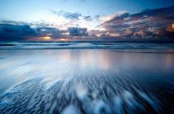 Sunset on the beach Stock Image