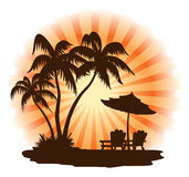 Sunset beach. Summer landscape: sunset, palm, chairs and umbrella Royalty Free Stock Image