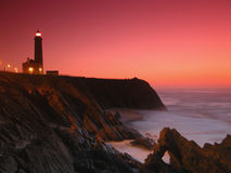 Sunset on the beach. Lighthouse - Sunset in the beach - Portugal - Portugal Royalty Free Stock Photos