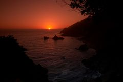 Sunset on the beach. Big Sur California royalty free stock image