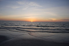 Sunset On The Beach. Tropical sunset on the beach with gentle waves Stock Photography