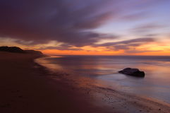 Sunset beach. Sunset at \Santa Rita\ beach near Lisbon, Portugal Royalty Free Stock Images