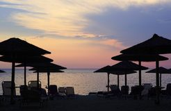 Sunset on the beach of Aegean Sea. Royalty Free Stock Photos