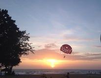 Sunset at beach. Air ballon at beach Stock Image