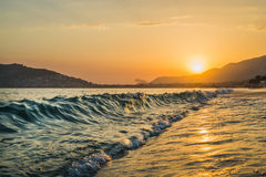 Sunset at the beach in Alanya, Turkey. View of the castle hill and sea Stock Images