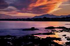 Sunset on the beach Ancón in the city of Marbella Royalty Free Stock Photo