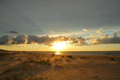 Sunset on beach. Baltic sea, Latvia Stock Image