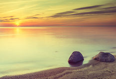 Sunset at a beach of the Baltic Sea, Latvia Royalty Free Stock Photo