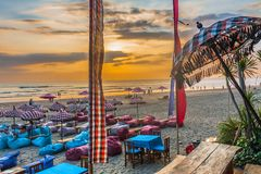 Sunset at the beach bar. Legian, Bali/Indonesia, August 2016: Sunset at the beach bar in Legian, Bali Royalty Free Stock Image