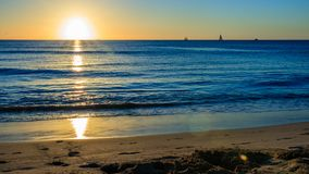 Sunset at the beach in Barbados Island, Caribbean. Idyllic evening at the beach in Barbados Caribbean island: White sand, clear turquoise water with small royalty free stock images