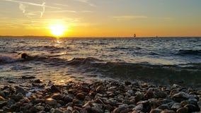 Sunset at beach stock photography
