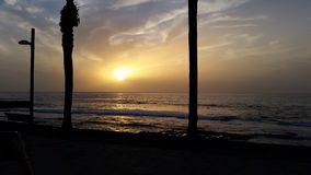 Sunset at beach. Beautiful sunset at mediterrane beach royalty free stock photos