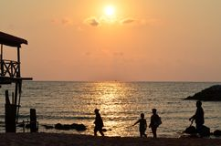 Sunset on the beach beautiful and nice shot. Peaople are walking and joging around the Royalty Free Stock Photos