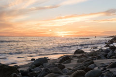 Sunset at the beach. A beautiful sunset a rocky beach in Malibu, CA Stock Photo