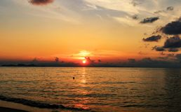 Sunset on the beach with beautiful sky royalty free stock photography