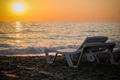 Sunset on the beach. Beautiful sunset on the warm beach of the côte d`azur Stock Photography