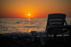 Sunset on the beach. Beautiful sunset on the warm beach of the côte d`azur Royalty Free Stock Image
