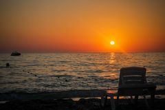 Sunset on the beach. Beautiful sunset on the warm beach of the côte d`azur Stock Photo