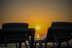 Sunset on the beach. Beautiful sunset on the warm beach of the côte d`azur Royalty Free Stock Images