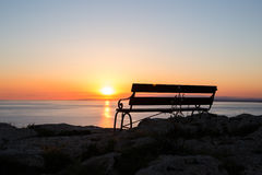 Sunset beach and bench Royalty Free Stock Images