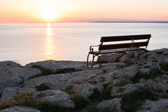 Sunset beach and bench Royalty Free Stock Photos