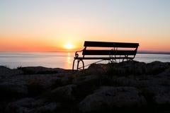 Sunset beach and bench Stock Photo