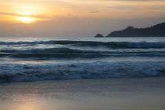Sunset on the beach . Big waves in the sunset royalty free stock photography