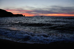Sunset on the beach with boat, Giglio Island, Tuscany Italy. Sundown on the beach with boat, Giglio Island, Tuscany Italy Royalty Free Stock Image