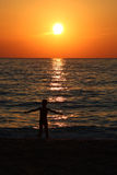 Sunset on the beach. Boy watching sunset on the beach Royalty Free Stock Images