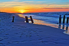 Sunset at the beach and breakwater Royalty Free Stock Images