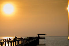 Sunset on beach and bridge silhouette Stock Photography