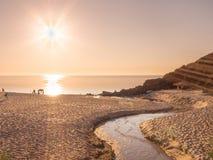 Sunset beach brook Stock Image
