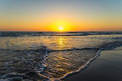 Sunset at beach in cadiz Spain stock photo