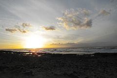 Sunset on the beach at the Canaries. Rough sea and cloudy sky in November Tenerife - Canaries Island stock photography