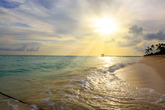 Sunset on the beach of caribbean sea. Royalty Free Stock Photos