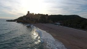 Sunset on the beach of Castle of the Marquises, Tamarit , Tarragona, Spain. A medieval castle with romanesque style on a small promontory overlooking the sea and stock video footage